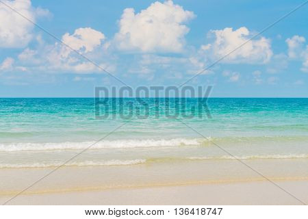 Beautiful white sand beach with blue sea and sky
