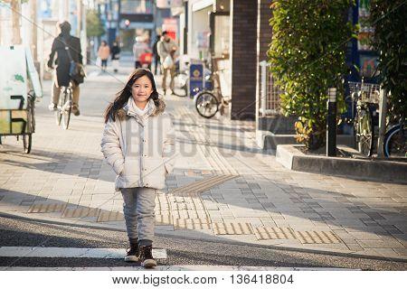 Beautiful asian girl waking in the street. Kyoto Osaka Japan