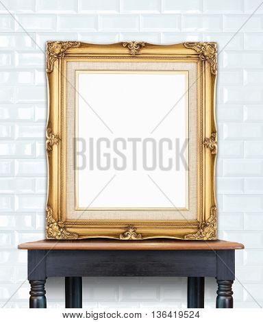 Blank Vintage Golden Photo Frame Lean At Ceramic Tile Wall On Wood Table