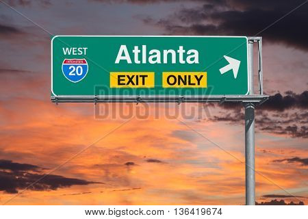 Atlanta Georgia exit only freeway sign with sunrise sky.