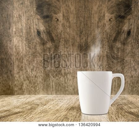 Hot White Coffee Cup On Wood Floor And Blur Wood Room,leave Space For Adding Content