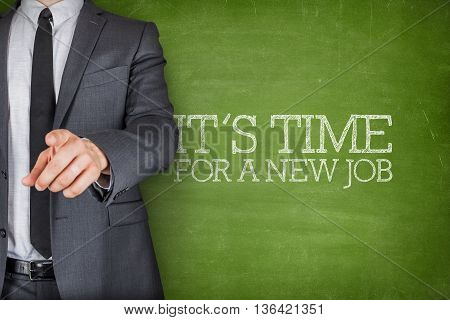 Its time for a new job on blackboard with businessman finger pointing