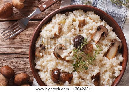 Italian Rice With Wild Mushrooms Close Up On The Table. Horizontal Top View