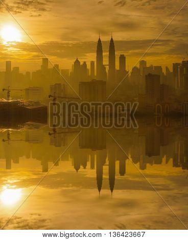 Sunrise in Kuala Lumpur with the silhouette of the Kuala Lumpur city skyline
