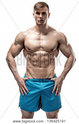 Strong Athletic Man showing muscular body and sixpack abs over white background