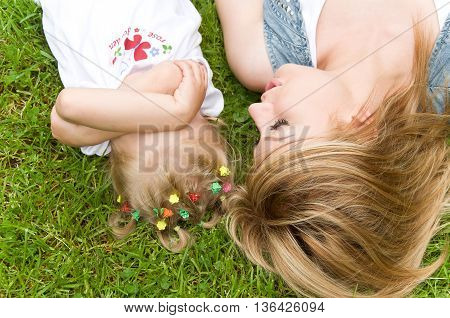 mother and daughter spend time in nature. daughter was mad at mom