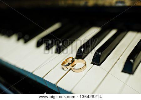 Wedding rings at the piano keys at wedding