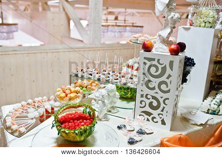 Decorated Watermelon With Candies And Other Sweets On Wedding Reception