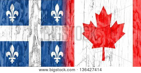 Image relative to politic relationships between Canada and Quebec. National flags textured by wood.