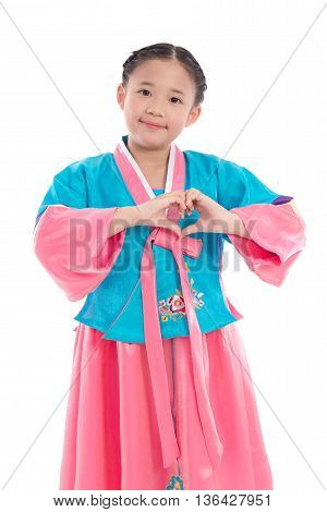Asian girl in Korean Traditional Dress making heart shape with fingers on white background isolated