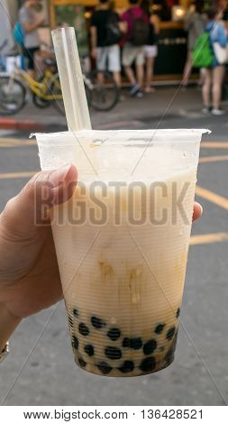 The tasty Taiwanese bubble tea drink (pearl milk tea) at food street market in Taipei, Taiwan.