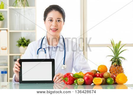 Doctor Nutritionist With Vegetable And Fruit Holding Blank Digital Tablet