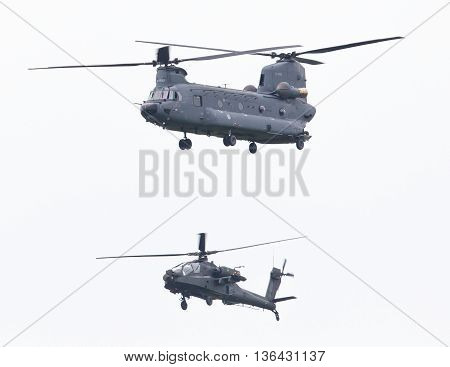 Leeuwarden, The Netherlands - Jun 11, 2016: Dutch Chinook And Apache Helicopter Flying During The Ro