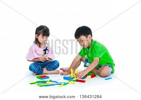 Asian Children Playing Toy Wood Blocks, Isolated On White Background.