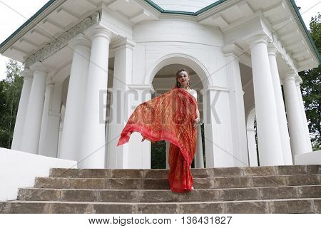 Girl In Red Indian Saree On The Stairs