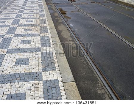 Tram Line With Black And White Cobble Sidewalk