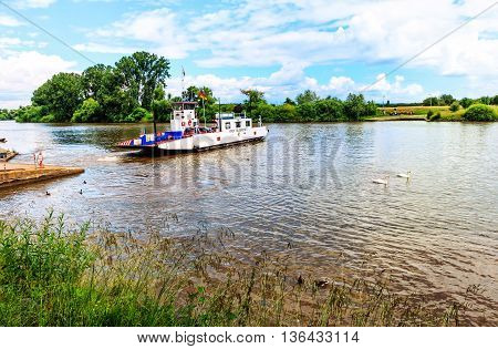 SELIGENSTADT, GERMANY-JUNE 26, 2016: The small ferry of Seligenstadt, historic medieval town on the Banks of the River Main, Hesse