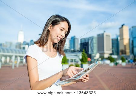 Woman looking on city map in Hong Kong