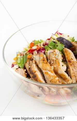 Grilled chicken salad in a glass bowl