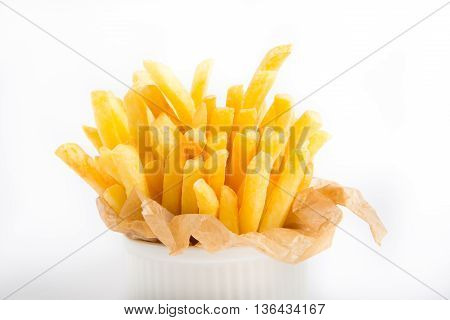 French fries in a paper wrapper on a white background