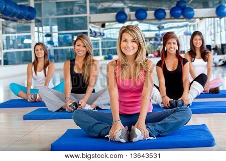 Group of women in a pilates class at the gym