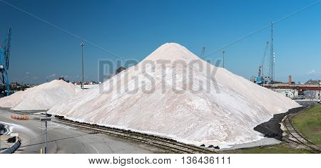 Salt factory in America on sunny day background