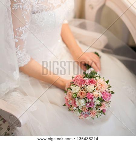 woman hands holding beautiful wedding bouquet close up