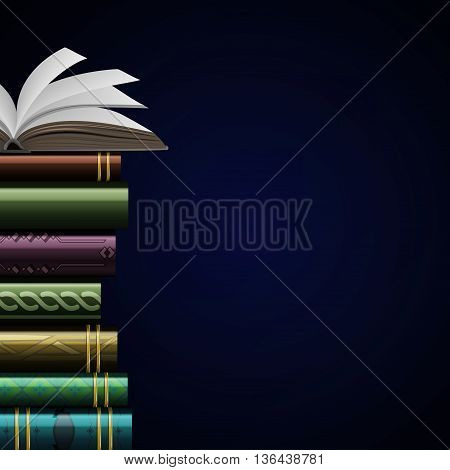 Stack of multi colored book isolated on a black background .