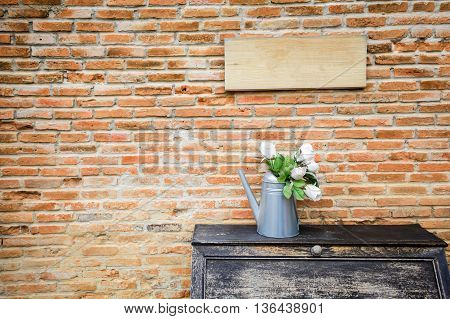 Beautiful Flowerpot Of Flowers On Wooden Cupboard In Red Vintage Brick Wall Background With Empty Wo