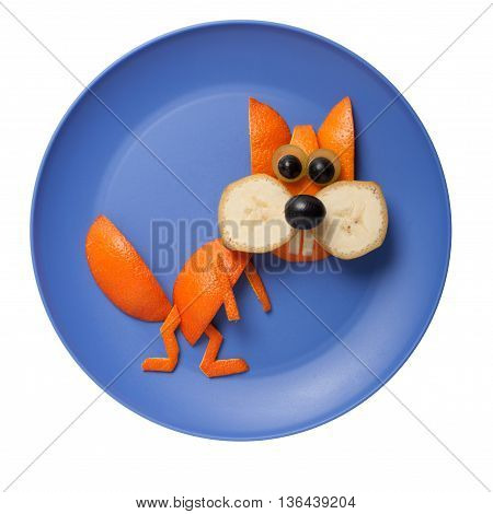 Funny squirrel made of fruits on blue plate