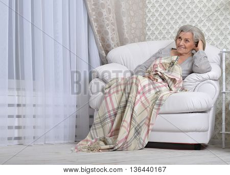 Portrait of a happy senior woman resting at home