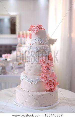 beautiful wedding cake. beautiful multi cake close up.