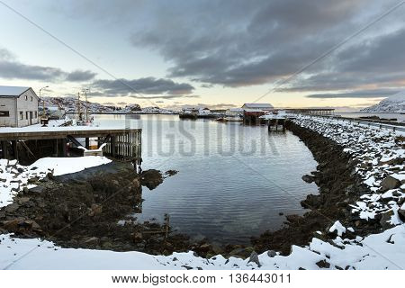 Small fishing harbor on Lofoten Islands in winter time North Norway