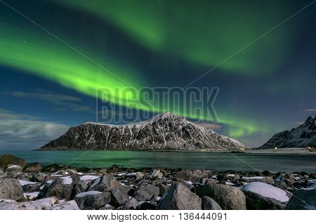 Aurora borealis over Skagsanden beach on Lofoten Islands Norway March 2016