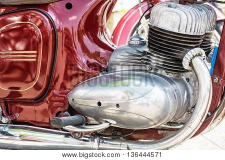 Detail of red veteran motorbike. Meeting bikers. Motor of motorcycle. Symbol of luxury lifestyle.