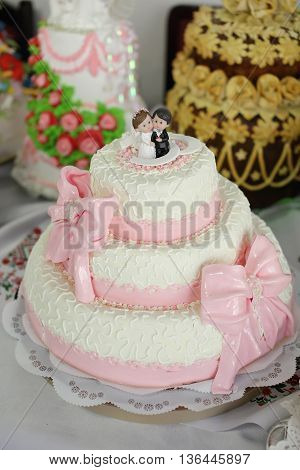 beautiful wedding cake with figurines close up