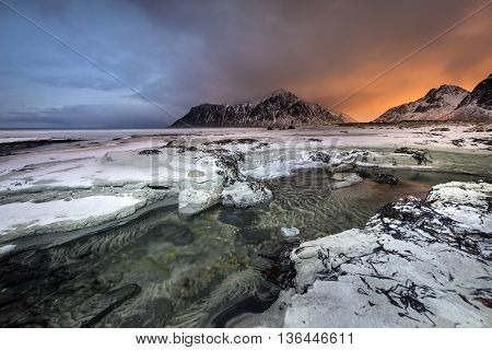 Sundown over Skagsanden Beach in the winter on the Lofoten Islands North Norway