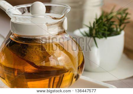 closeup of glass teapot with herbal tea