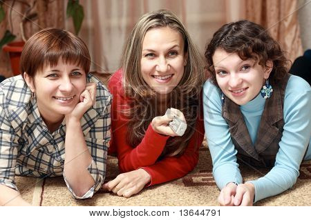 Three women watching television