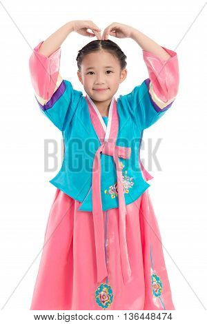 Asian girl in Korean Traditional Dress making heart shape with arms on white background isolated