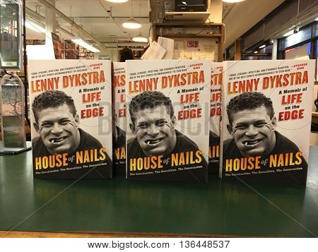 HUNTINGTON, NY-JUNE 28: Former MLB player Lenny Dykstra signs copies of his book