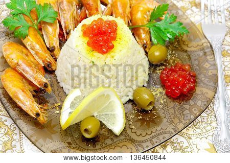 steamed rice with red caviar shrimp lemon and olives close-up. horizontal photo.
