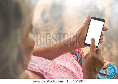 Woman elderly Using a Smart Phone. Vintage filter.