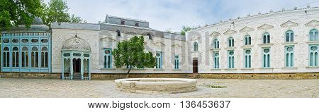 BUKHARA UZBEKISTAN - APRIL 29 2015: The white walls of Sitorai Mokhi-Khosa Palace covered with the ornament fretwork on ganch on April 29 in Bukhara.