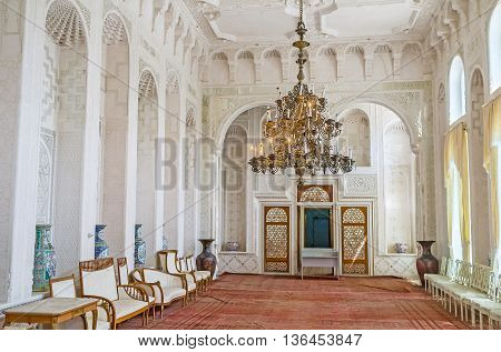 BUKHARA UZBEKISTAN - APRIL 29 2015: The white Hall for state receptions of Sitorai Mokhi-Khosa Palace decorated with the tracery fretwork on ganch on April 29 in Bukhara.