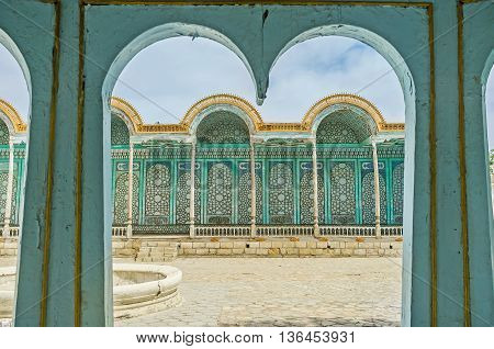 BUKHARA UZBEKISTAN - APRIL 29 2015: The summer terrace of Sitorai Mokhi-Khosa Palace through the frames of its porch on April 29 in Bukhara.