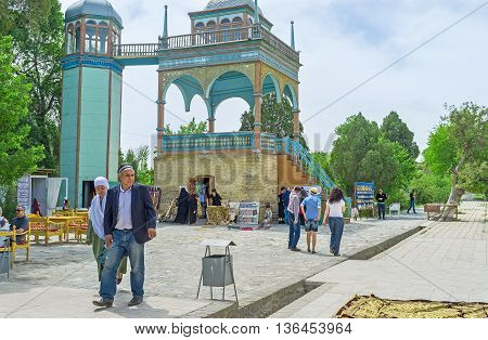 BUKHARA UZBEKISTAN - APRIL 29 2015: The colorful wooden Emir's pavilion of Sitorai Mokhi-Khosa Palace located next to the pool and harem on April 29 in Bukhara.