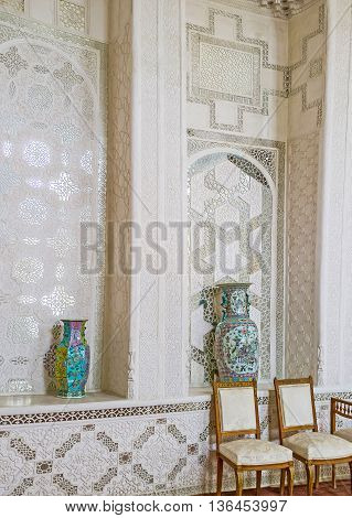 BUKHARA UZBEKISTAN - APRIL 29 2015: Thewall of the Hall for state receptions of Sitorai Mokhi-Khosa Palace covered with lace of fretwork on ganch on April 29 in Bukhara.