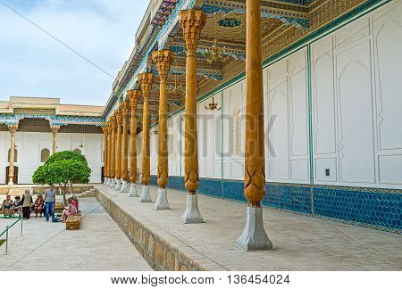 BUKHARA UZBEKISTAN - APRIL 29 2015: The architectural masterpiece of Sheikh Nakshbund Mausoleum decorated with carved wood and colorful islamic patterns on April 29 in Bukhara.