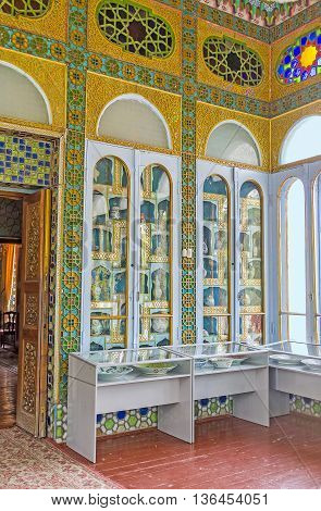 BUKHARA UZBEKISTAN - APRIL 29 2015: The collection of old porcelain sets and vases in the glass room of Sitorai Mokhi-Khosa Palace on April 29 in Bukhara.